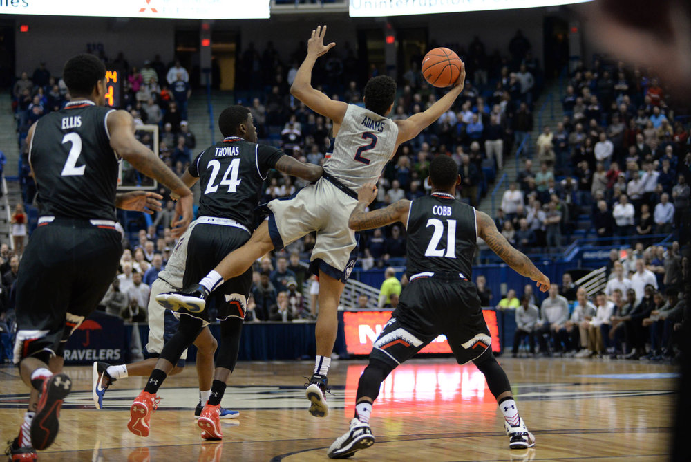 Guard Jalen Adams grabs a pass during a game against the Bearcats on Jan. 28, 2016 at the XL Center. (File Photo/The Daily Campus)