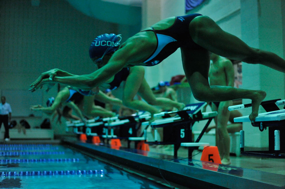 Members of the UConn swim team start a race on Jan. 20, 2017. (Jason Jiang/The Daily Campus)