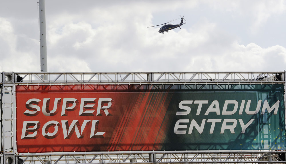 A helicopter flies over NRG Stadium for the NFL Super Bowl 51 football game Wednesday, Feb. 1, 2017, in Houston. (Morry Gash/AP)