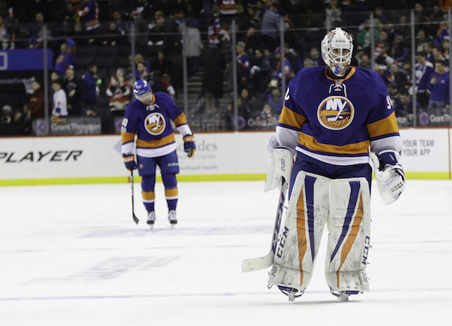 New York Islanders goalie Jean-Francois Berube (30) leaves the ice after the team's NHL hockey game against the Carolina Hurricanes on Saturday, Feb. 4, 2017, in New York. The Hurricanes won 5-4. The Islanders and the NHL are exploring options for the Islanders' new home. (AP Photo/Frank Franklin II)