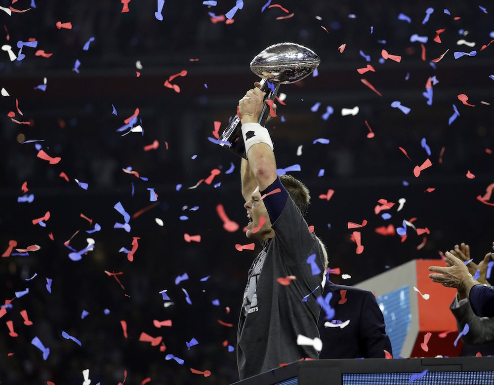New England Patriots' Tom Brady hoists the Vince Lombardi Trophy after the NFL Super Bowl 51 football game against the Atlanta Falcons Sunday, Feb. 5, 2017, in Houston. The New England Patriots won 34-28. (AP Photo/Eric Gay)