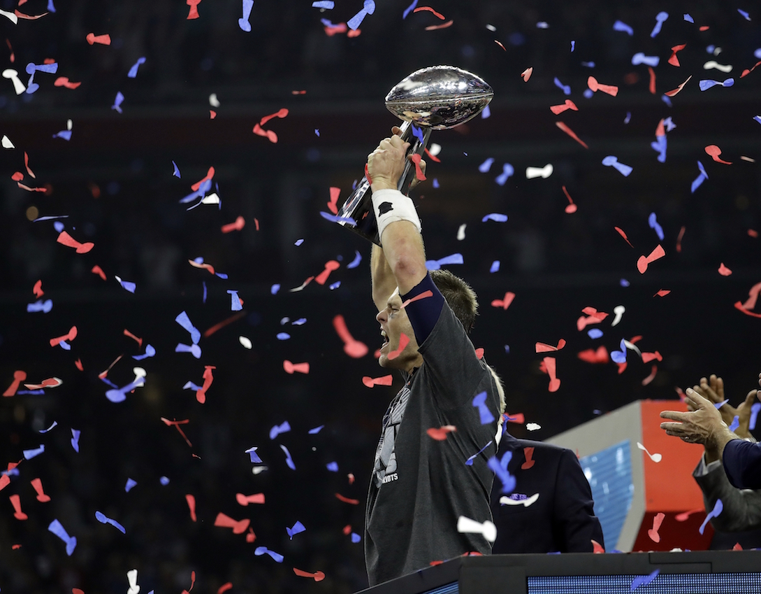c2acacd1 New England Patriots'Tom Brady hoists the Vince Lombardi Trophy after  the NFL