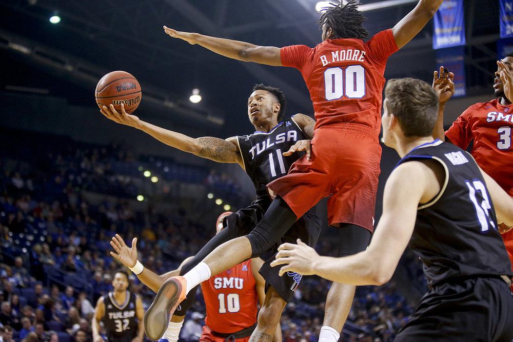 Tulsa guard Pat Birt (11) shoots against SMU forward Ben Moore during an NCAA college basketball game in Tulsa, Okla., Saturday, Feb. 4, 2017. (Ian Maule/Tulsa World via AP)