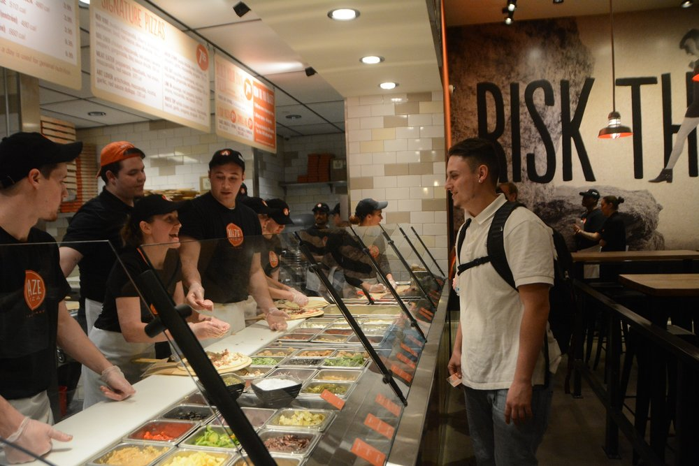 A student orders his pizza during Blaze Pizza's grand opening on January 29th, 2016. (Bailey Wright/The Daily Campus)