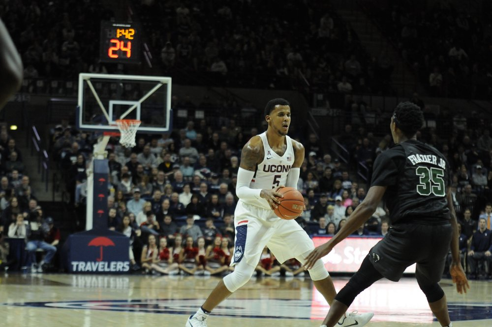 Vance Jackson looks to pass during UConn's game against Tulane on January 28th, 2017. (Olivia  Stenger/The Daily Campus)