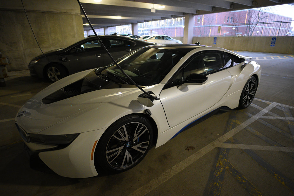 A BMW i8 parks at South garage and get charged by the on-campus charge station. (Zhelun Lang/The Daily Campus)