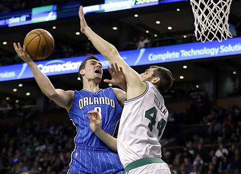 Orlando Magic guard Mario Hezonja (8) goes up for a shot against Boston Celtics center Tyler Zeller (44) during the second half of an NBA basketball game, Friday, Jan. 27, 2017, in Boston. Our writer believes Hezonja is being under appreciated as a player this season. (Elise Amendola/ AP)