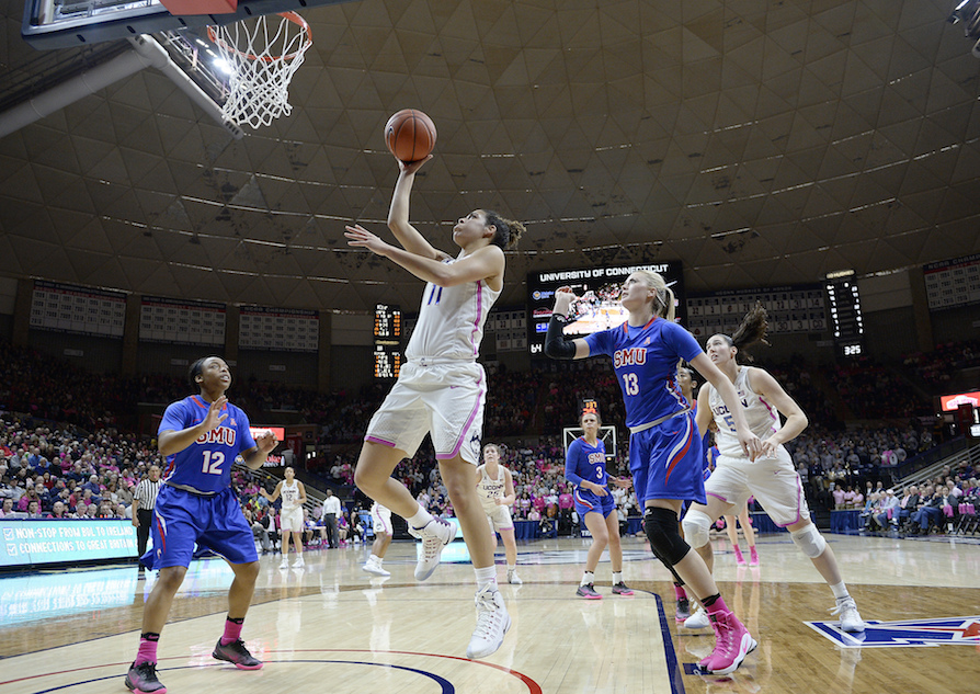 Connecticut's Kia Nurse, center, shoots between SMU's Morgan Bolton, left, and Klara Bradshaw, right, in the second half of an NCAA college basketball game, Saturday, Feb. 11, 2017, in Storrs, Conn. UConn extended its NCAA record winning streak to 99 games with an 83-41 win. (AP Photo/Jessica Hill)