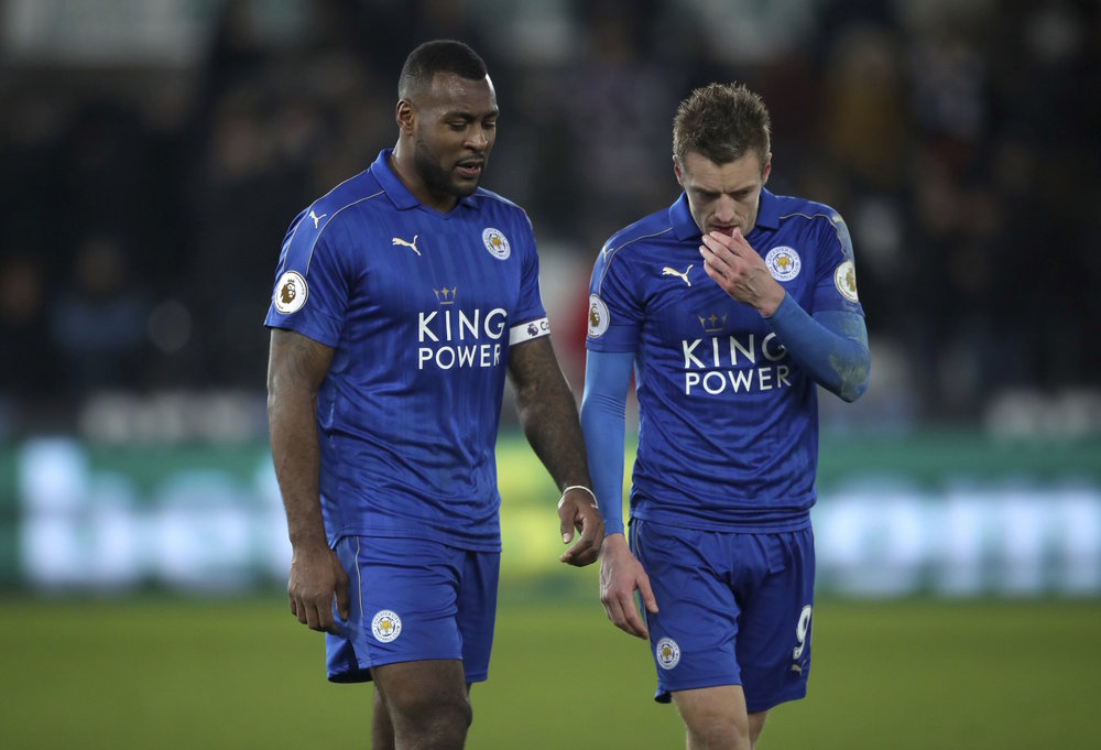 Leicester City's Wes Morgan, left, and Jamie Vardy leave the pitch after the English Premier League match Swansea against Leicester at the Liberty Stadium, Swansea, Wales, Sunday Feb. 12, 2017. (Nick Potts/PA via AP)
