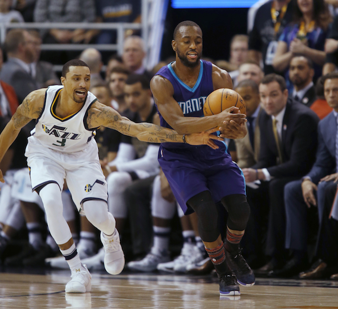 Utah Jazz guard George Hill (3) tries to knock the ball from Charlotte Hornets guard Kemba Walker during the second half of an NBA basketball game, Saturday, Feb. 4, 2017, in Salt Lake City. The Jazz defeated the Hornets 105-98. (AP Photo/George Frey)