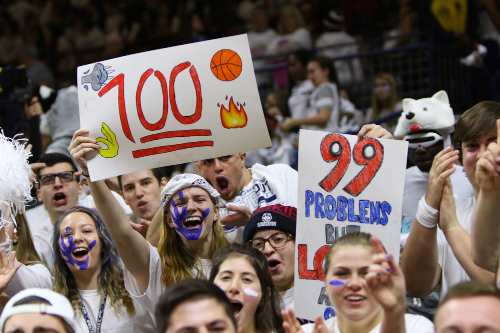 The student section holds up a variety of signs supporting UConn's pursuit of the streak. (Jackson Haigis/The Daily Campus)
