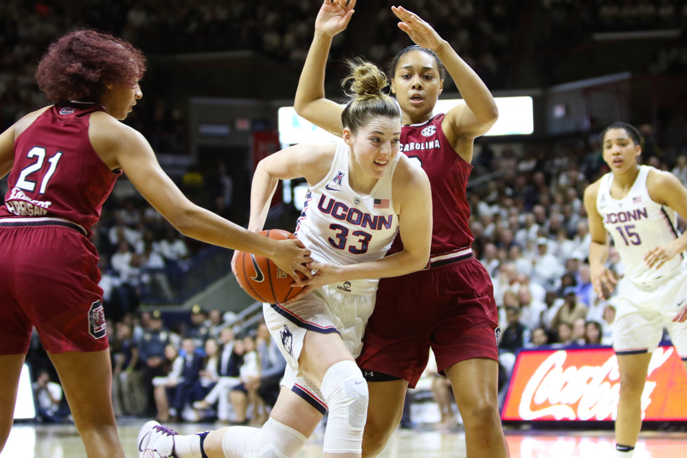 Katie Lou Samuelson attempts to retain possession of the ball while driving to the hoop. Samuelson was held to just 6 points on 2-for-12 shooting. (Jackson Haigis/The Daily Campus)
