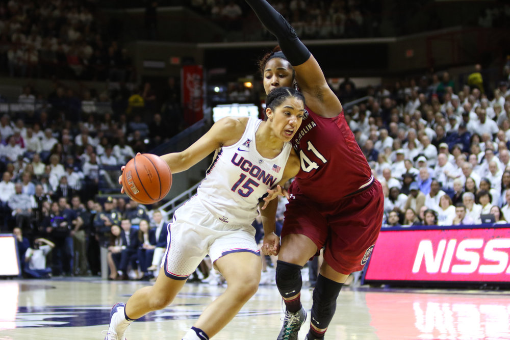 Gabby Williams drives to the basket against South Carolina's Alaina Coates. Williams led the Huskies with 26 points and 14 rebounds. (Jackson Haigis/The Daily Campus)
