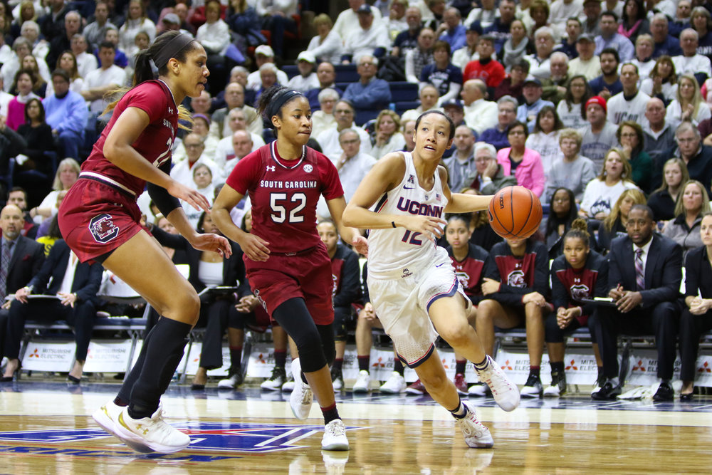 Saniya Chong looks to pass around two South Carolina defenders. Chong played 38 minutes of a possible 40. (Jackson Haigis/The Daily Campus)