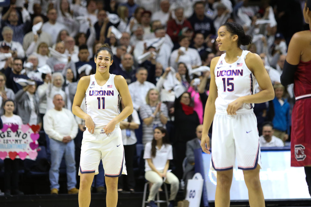 UConn's Kia Nurse (left) and Gabby Williams share a laugh before tipoff in their game against No. 6 South Caroline on Monday, February 14, 2017. (Jackson Haigis/The Daily Campus)
