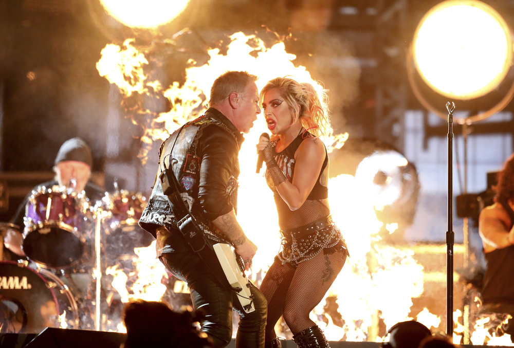"Lady Gaga, right, and James Hetfield of ""Metallica"" perform ""Moth Into Flame"" at the 59th annual Grammy Awards on Sunday, Feb. 12, 2017, in Los Angeles. (Matt Sayles/AP)"