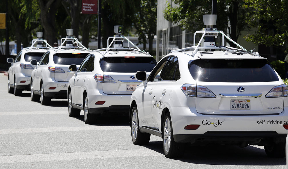 A row of Google self-driving Lexus cars at a Google event outside the Computer History Museum in Mountain View, Calif. California regulators release safety reports filed by 11 companies that have been testing self-driving car prototypes on public roads on Wednesday, Feb. 1, 2017. T (Eric Risberg/ AP)