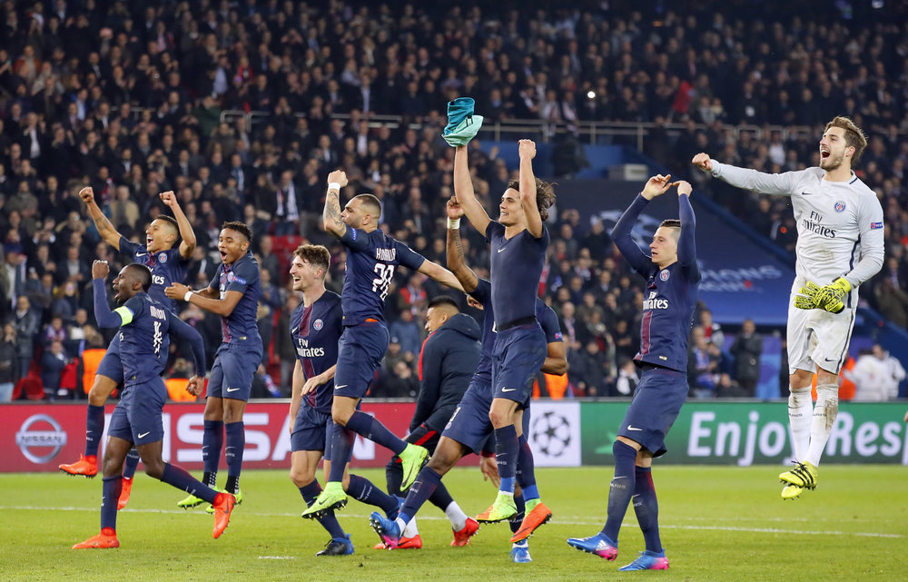 PSG players celebrate after the Champion's League round of 16, first leg soccer match between Paris Saint Germain and Barcelona at the Parc des Princes stadium in Paris, Tuesday, Feb. 14, 2017. PSG won the match 4-0. (Francois Mori/ AP)