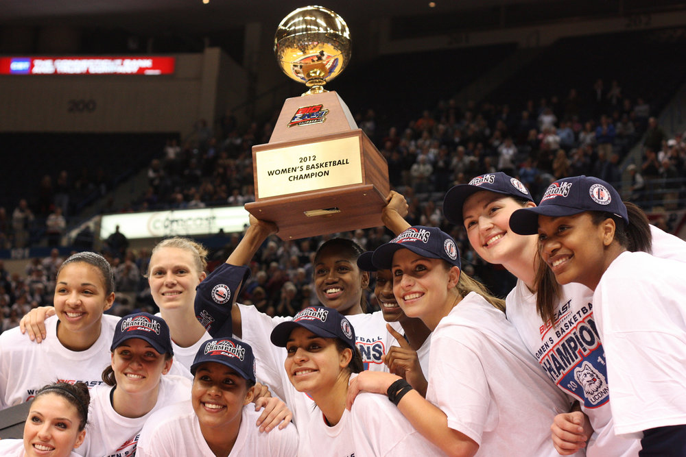 UConn women's basketball posing with the trophy after their 2012 NCAA championship win in the Big East Conference.  After leaving the Big East Conference four years ago, UConn is considering rejoining the conference.  (File Photo/The Daily Campus)