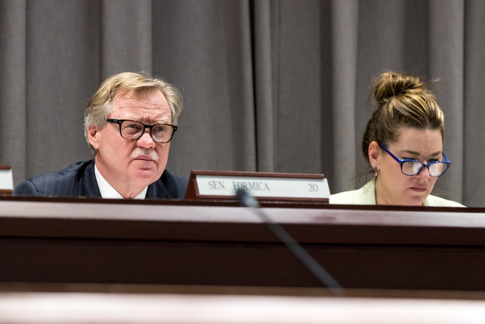 Senators Paul Formica and Mae Flexer listen to testimony from USG members regarding state budget cuts directed at UConn on Wednesday afternoon.