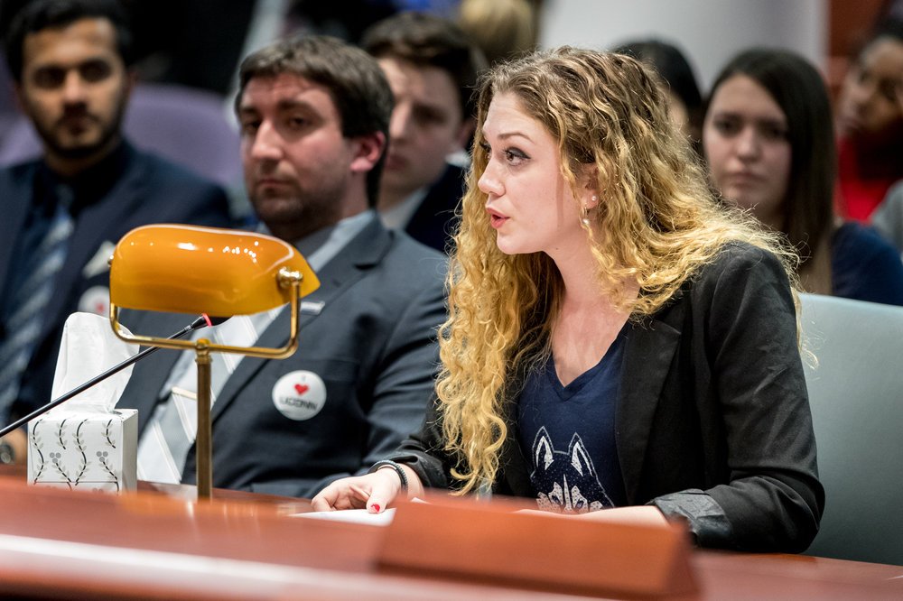 USG External Affairs chairperson Haley Hinton testifies in front of the state Appropriations Committee on Wednesday, Feb. 15 alongside member of the UConn student body.