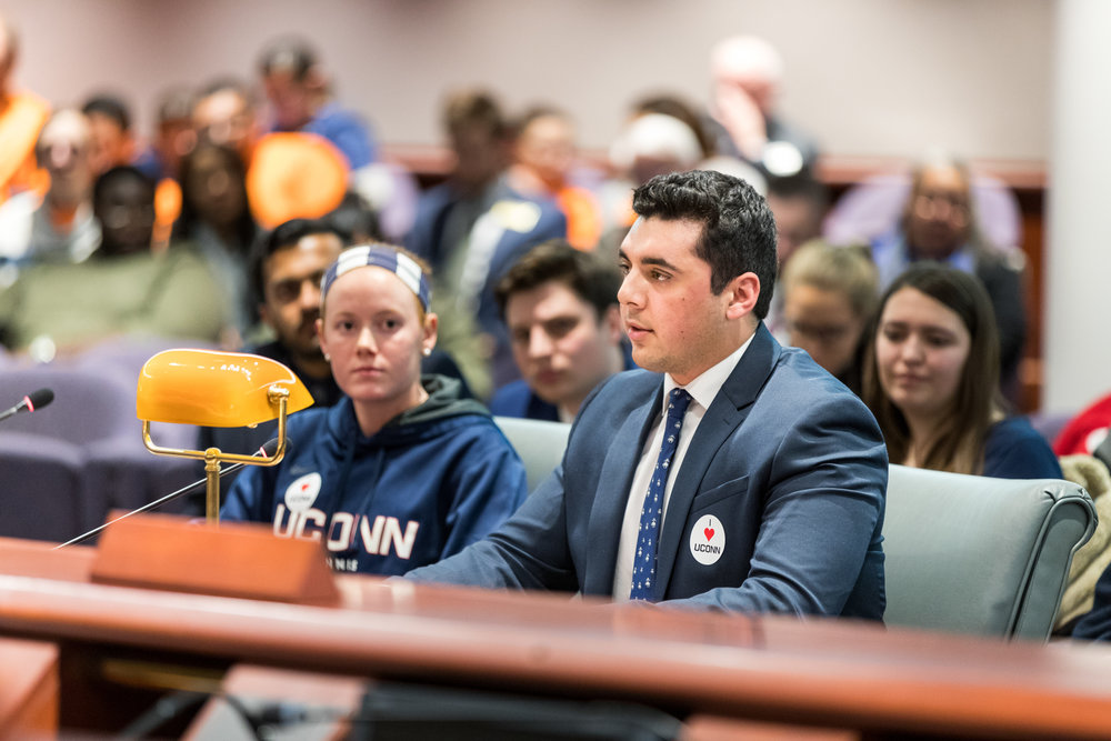 USG member Humza Mirza speaks to the state Appropriations Committee in order to convince them not to cut funding toward the university on Wednesday, Feb. 15.