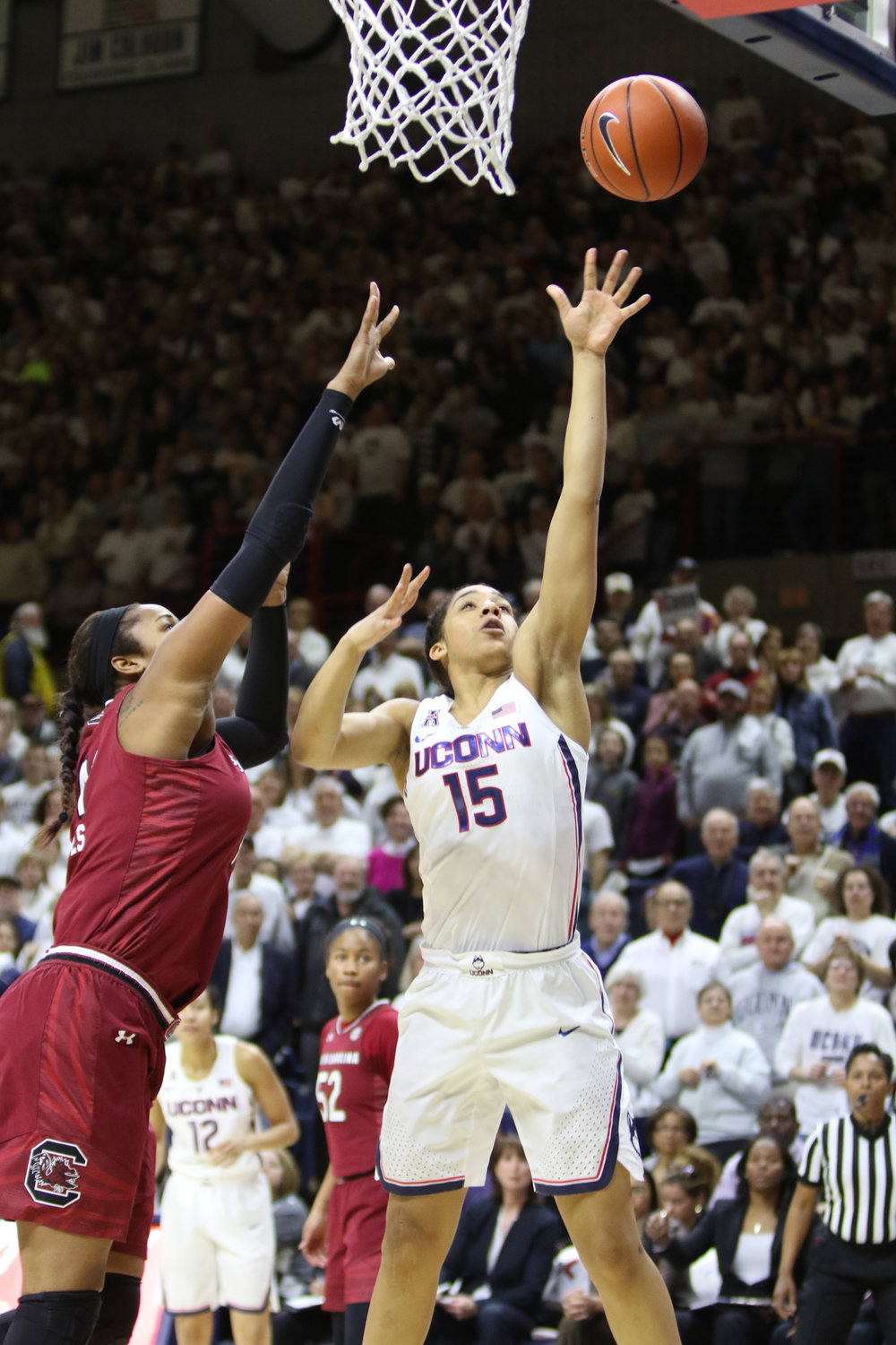 Gabby Williams floats a basket over a South Carolina defender during the Huskies 66-55 victory over the Gamecocks on Feb. 13, 2017.