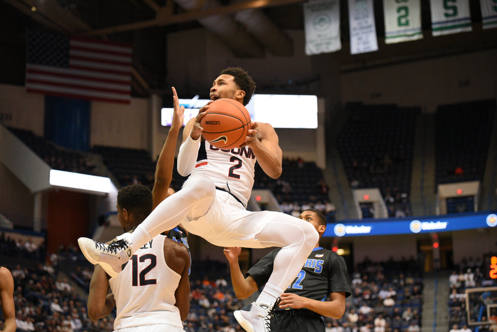 Sophomore guard Jalen Adams completes a layup during the Huskies 65-62 victory over the Memphis Tigers on Thursday, Feb. 16, 2017 at the XL Center in Hartford. Adams led the team in baskets, scoring 19 points. (Zhelun Lang/The Daily Campus)