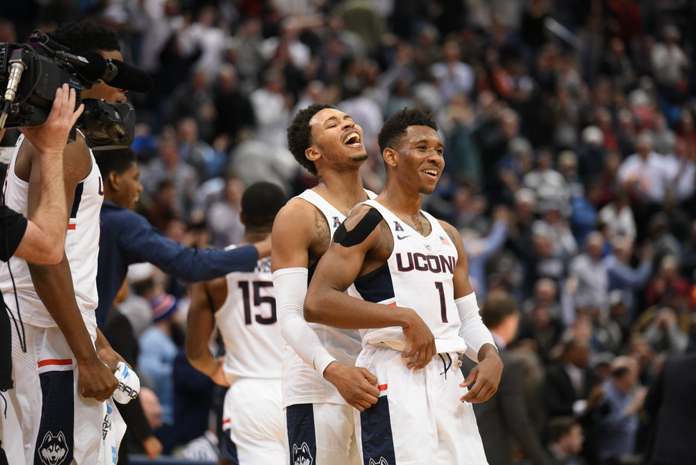 Jalen Adams and Christian Vital (1) celebrate following the team's victory. (Zhelun Lang/The Daily Campus)