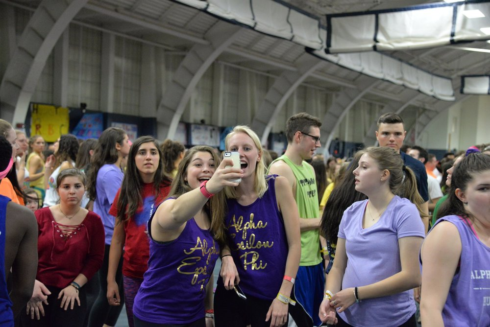 Students gather in the Greer Field House to participate in the annual 18 hour dance marathon HuskyTHON to raise money for Connecticut Children's Medical Center from Saturday, Feb. 18 to Sunday, Feb. 19, 2017. (Amar Batra/The Daily Campus)