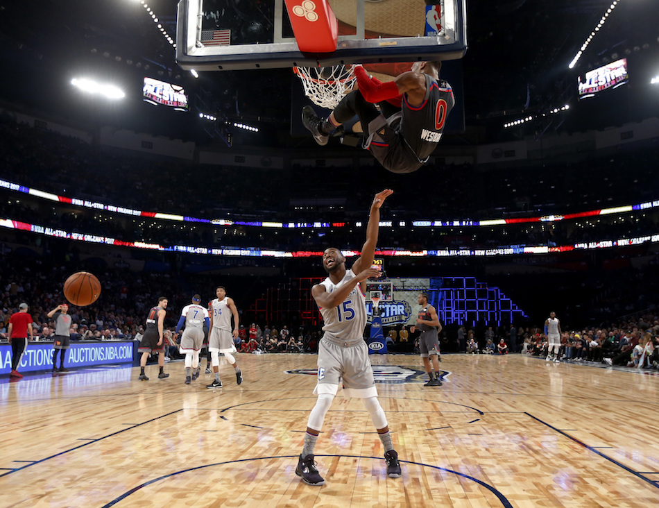 Eastern Conference guard Kemba Walker of the Charlotte Hornets (15) reacts as Western Conference guard Russell Westbrook of the Oklahoma City Thunder (0) hangs from the rim on an attempted slam dunk during the first half of the NBA All-Star basketball game in New Orleans, Sunday, Feb. 19, 2017. (AP Photo/Gerald Herbert, Pool)