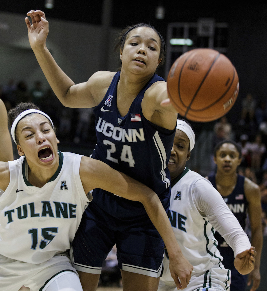 Tulane guard Tene Thompson (15) blocks Connecticut guard/forward Napheesa Collier (24) during the second half of an NCAA college basketball game in New Orleans, Saturday, Feb. 18, 2017. (AP Photo/Sophia Germer)
