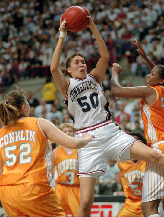 FILE - In this Jan. 16, 1995, file photo, Connecticut's Rebecca Lobo (50) pulls in a rebound as Tennessee's Abby Conklin (52) and Tiffani Johnson, right, defend during the first half of an NCAA college basketball game in Storrs, Conn., Monday, Jan. 16, 1995.Lobo is among the 14 finalists unveiled Saturday, Feb. 18, 2017, for this year's Basketball Hall of Fame induction class. (AP Photo/Bob Child, File)