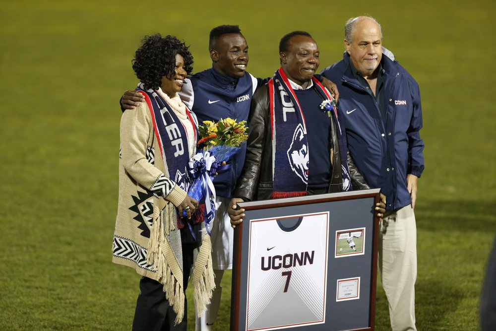 UConn soccer head coach Ray Reid (far right) has made another donation to UConn Athletics. He's pictured here with Kwame Awuah (middle-left). (Tyler Benton/The Daily Campus)