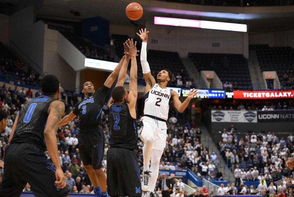 UConn sophomore Jalen Adams rises above two Memphis defenders in a game at the XL Center on February 16th, 2017. (Zhelun Lang/The Daily Campus)