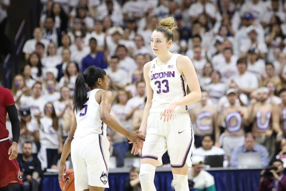 UConn's Katie Lou Samuelson (right) high fives teammate Crystal Dangerfield during the Huskies' game against South Carolina on February 13th, 2017 at Gampel Pavilion. (Jackson Haigis/The Daily Campus)