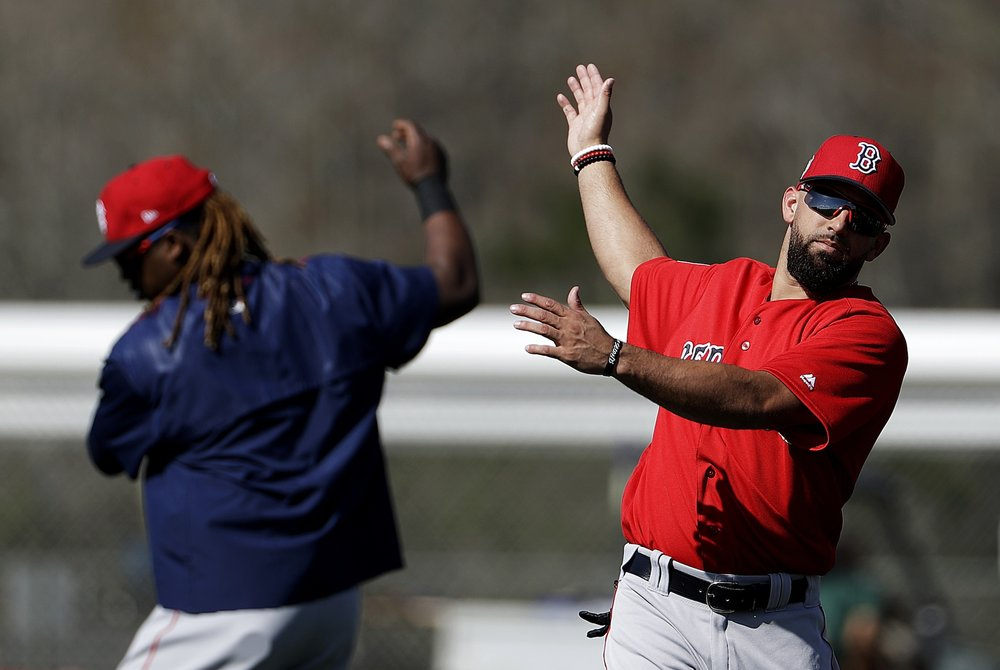 Boston Red Sox's Deven Marrero, right, and Hanley Ramirez warm up during a spring training baseball workout in Fort Myers, Fla., Sunday, Feb. 19, 2017. (David Goldman/AP Photo)