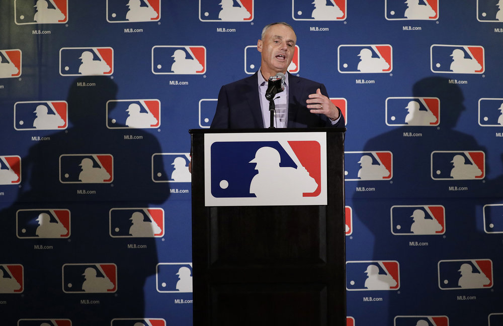 Major League Baseball Commissioner Rob Manfred answers questions at a news conference Tuesday, Feb. 21, 2017, in Phoenix.  Recently, Manfred has opted for many game-shortening techniques for major league games (Morry Gash/AP)