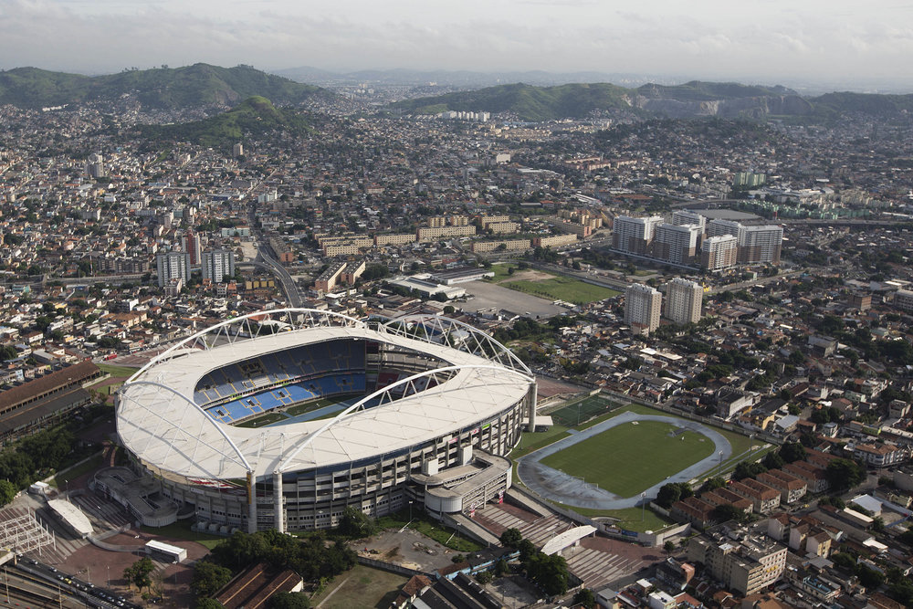 This April 11, 2013 file photo shows an aerial view of the Botafogo soccer club's stadium commonly known as Engenhao, though it was called the Olympic Stadium for the 2016 Rio Games, used for track and field events, in Rio de Janeiro, Brazil. Recently the stadium and all other facilities have become a financial burden for the country. (Felipe Dana/ AP)