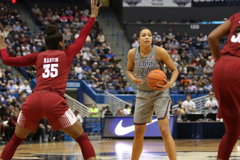 The UConn women's basketball team defeated Temple 90-45 Wednesday night at the XL Center in Hartford behind 31 points and 13 rebound from Napheesa Collier. With the win, their 102nd in a row, the Huskies clinched the American Athletic Conference regular season title. They return to action on Saturday at Gampel Pavilion against Memphis. (Jackson Haigis/ The Daily Campus)