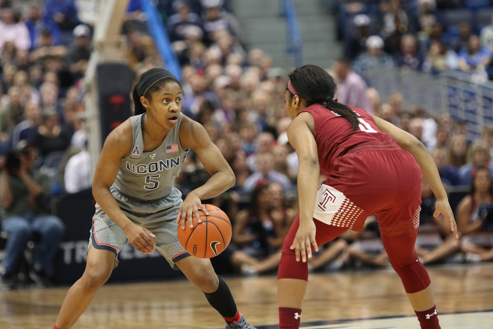 Pictured: Crystal Dangerfield (number 5) against a Temple opponent Wednesday, Feb. 22, 2017 at the XL Center in Hartford.   The Huskies pulled out a dominating win 90-45.  (Jackson Haigis, The Daily Campus)