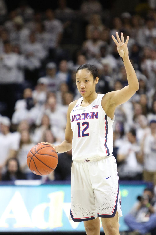 Saniya Chong signals to her teammates during the Huskies historic 66-55 win over South Carolina on Monday, Feb. 12. 2017. (Jackson Haigis/The Daily Campus)