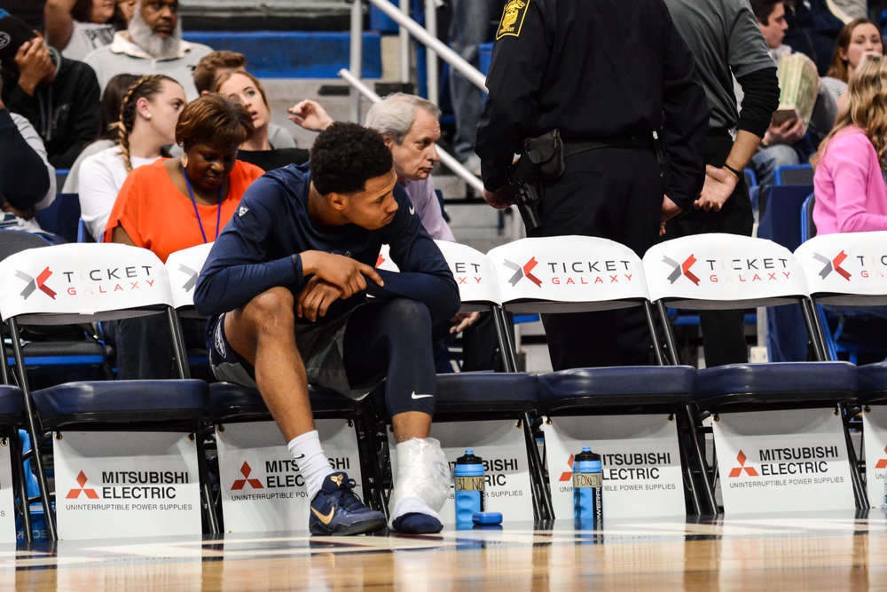 UConn guard Jalen Adams sits on the bench after a first half ankle injury. After the game, Kevin Ollie called the injury a sprain. (Jason Jiang/Associate Photo Editor/The Daily Campus)