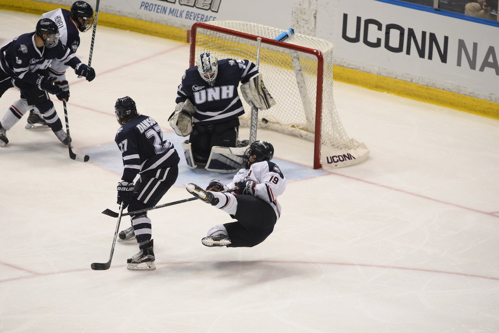 UConn men's hockey beats UNH at the XL center at February 25, at the XL Center with a final score of 4-2. Evan Richardson (#19) had a highlight reel goal in the victory. (Zhelun Lang/The Daily Campus)