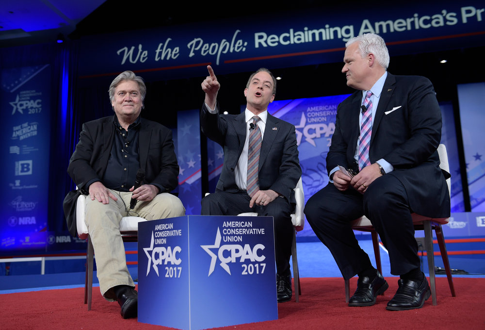 White House Chief of Staff Reince Priebus, center, with White House strategist Stephen Bannon, left, and American Conservative Chairman Matt Schlapp, speaks during the Conservative Political Action Conference (CPAC) in Oxon Hill, Md., Thursday, Feb. 23, 2017. (Susan Walsh/AP)