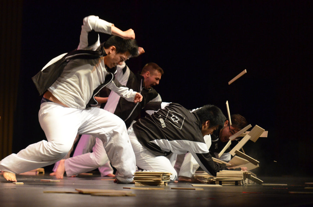 T-Huskies sends boards flying as a part of their performance in Asian Nite 2017 on Saturday evening at the Jorgensen Center for the Performing Arts. (Akshara Thejaswi/The Daily Campus)