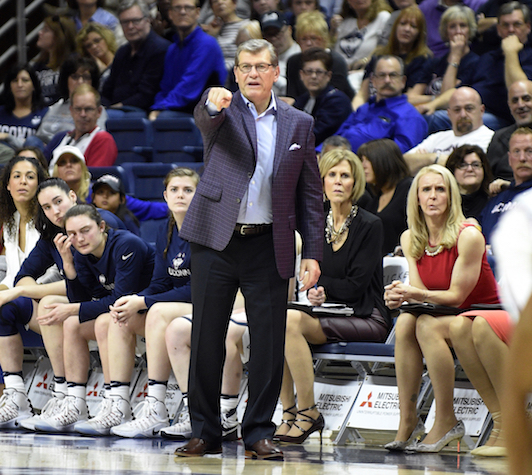 Connecticut coach Geno Auriemma signals to his team during the first half of Connecticut's 91-48 victory over Memphis in an NCAA college basketball game in Storrs, Conn., Saturday, Feb. 25, 2017. (AP Photo/Fred Beckham)