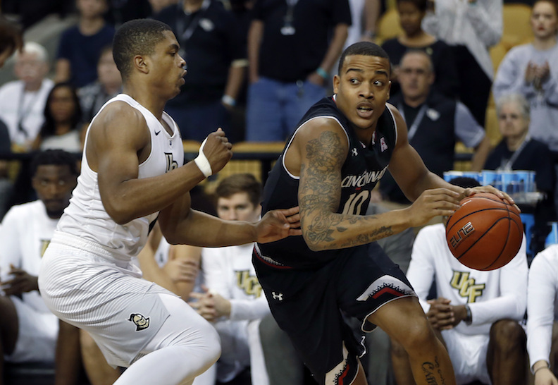 Cincinnati guard Troy Caupain (10) drives around Central Florida guard B.J. Taylor (1) during the first half of an NCAA college basketball game in Orlando, Fla., on Sunday, Feb. 26, 2017. (AP Photo/Reinhold Matay)