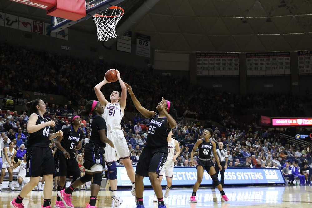 UConn's Natalie Butler rises above Memphis defenders during last Saturday's 91-48 win over the Tigers. (Jackson Haigis/The Daily Campus)