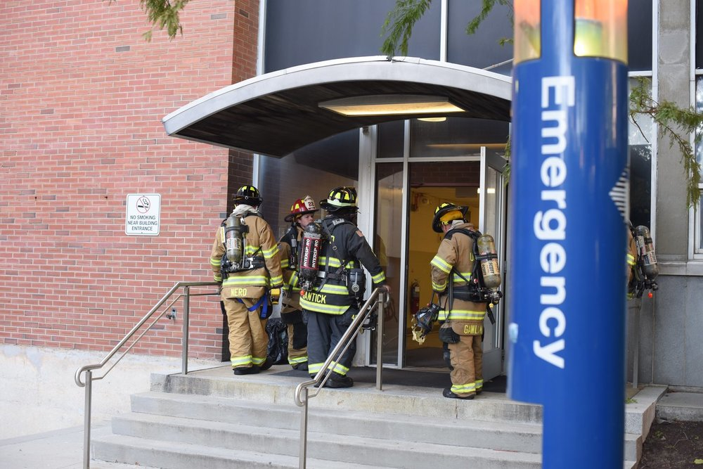 The UConn Fire Department responds to a fire in a basement laboratory of the Torrey Life Sciences building on Oct. 18, 2016. The building was evacuated today due to odor issues coming from repairs done to the building. (Zhelun Lang/The Daily Campus)